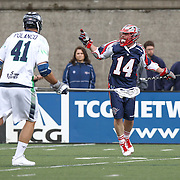Ryan Boyle #14 of the Boston Cannons directs other members of the Boston Cannons during the game at Harvard Stadium on April 27, 2014 in Boston, Massachusetts. (Photo by Elan Kawesch)