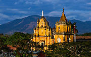 The twin spires of the Baroque Iglesia de la Recoleccion rise above the city of Leon, Nicaragua.