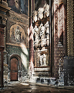 Afternoon sunlight highlights statues in the old St. Eustache Church In Paris, France. Built in the 1600's, it was ransacked and used as a barn during the French Revolution.  Aspect Ratio 1w x 1.25h