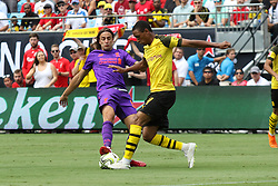 July 22, 2018 - Charlotte, NC, U.S. - CHARLOTTE, NC - JULY 22: Lazar Markovic (50) of Liverpool and Abdou Diallo (4) of Borussia Dortmund fight for the ball during the International Champions Cup soccer match between Liverpool FC and Borussia Dortmund in Charlotte, N.C. on July 22, 2018.(Photo by John Byrum/Icon Sportswire) (Credit Image: © John Byrum/Icon SMI via ZUMA Press)