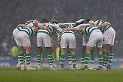 Celtic huddle in the drizzle before the Betfred Cup Final between Celtic and Aberdeen at Hampden Park, Glasgow, United Kingdom on 2 December 2018.