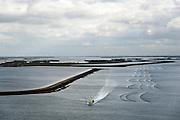 Nederland, Zeeland, Philipsdam, 23-10-2013; Meetvaartuig van Rijkswaterstaat de 'Regulus', omgeving Krammersluizen .<br /> Rechtsboven in beeld mosselhangculturen.<br /> A survey ship of the Department of Public Works, sails near the Krammersluizen.<br /> luchtfoto (toeslag op standaard tarieven);<br /> aerial photo (additional fee required);<br /> copyright foto/photo Siebe Swart.