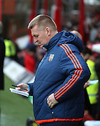 Brentford Head Coach Dean Smith checking his notes during the Sky Bet Championship match between Brentford and Charlton Athletic at Griffin Park, London, England on 5 March 2016. Photo by Matthew Redman.
