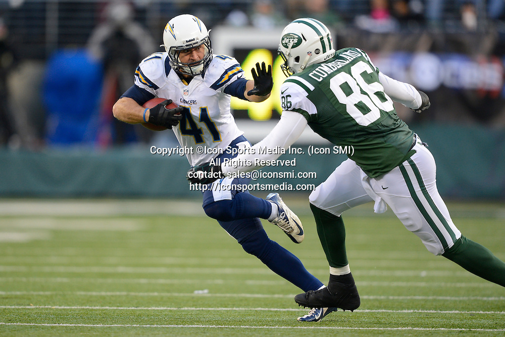 23 December 2012: San Diego Chargers strong safety Corey Lynch (41) runs from New York Jets tight end Jeff Cumberland (86) after a interception during a week 16 NFL matchup between the San Diego Chargers and New York Jets at MetLife Stadium in East Rutherford, New Jersey. The Chargers defeated the Jets 27-17.