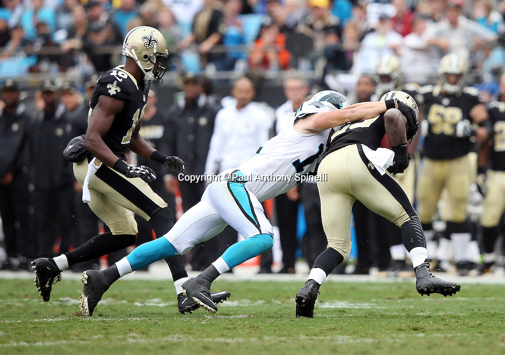 Carolina Panthers wide receiver Brenton Bersin (11) tackles New Orleans Saints running back Khiry Robinson (29) during the 2015 NFL week 3 regular season football game against the New Orleans Saints on Sunday, Sept. 27, 2015 in Charlotte, N.C. The Panthers won the game 27-22. (©Paul Anthony Spinelli)