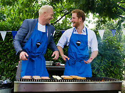Client: Royal Foundation. Prince Harry BBQ's with Iwan Thomas ' for the Heads Together ' campaign. Photo: David Poultney.
