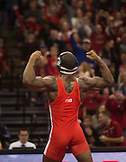 Nebraska's TJ Dudley celebrates after pinning Iowa's Sammy Brooks during the Husker's duel against Iowa at the Bob Devaney Sports Center in Lincoln, Neb., on Jan. 24, 2016. Iowa defeated Nebraska.