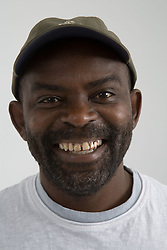 Close up portrait of a man laughing,