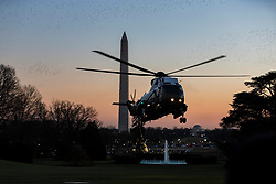 A flock of birds flies above the South Lawn of the White House with the Washington Monument in the background as Marine One carrying United States President Donald J. Trump approaches its landing zone at the White House on December 21st, 2017 in Washington, D.C. Credit: Alex Edelman / CNP. 21 Dec 2017 Pictured: Marine One carrying United States President Donald J. Trump lands on the South Lawn of the White House as Trump returns from visiting wounded service members at Walter Reed Military Hospital on December 21st, 2017 in Washington, D.C. Credit: Alex Edelman / CNP. Photo credit: Alex Edelman - CNP / MEGA TheMegaAgency.com +1 888 505 6342