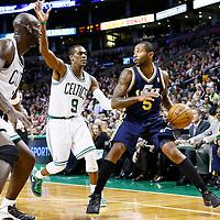 14 November 2012: Utah Jazz point guard Mo Williams (5) looks to pass the ball past Boston Celtics point guard Rajon Rondo (9) and Boston Celtics power forward Kevin Garnett (5) during the Boston Celtics 98-93 victory over the Utah Jazz at the TD Garden, Boston, Massachusetts, USA.