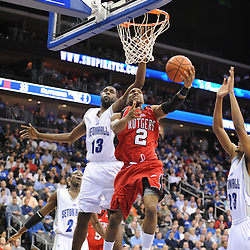 Jan 29, 2009; Newark, NJ, USA; Rutgers guard Anthony Farmer (2) puts up a reverse layup against Seton Hall center Mike Davis (13) during the second half of Seton Hall's 70-67 victory at the Prudential Center.