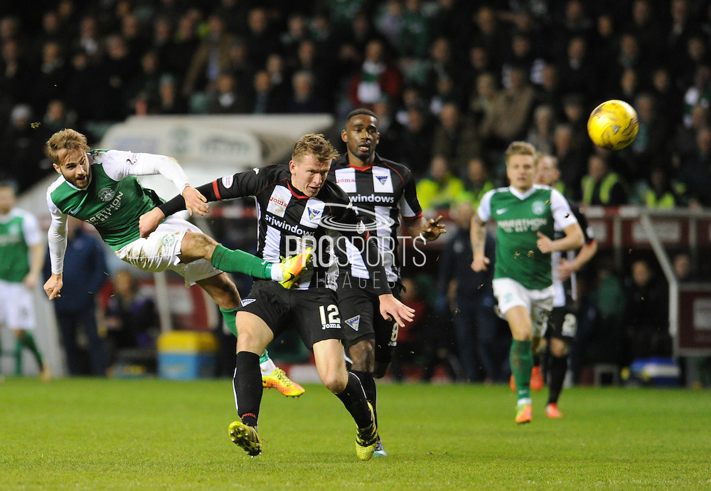 Andrew Shinnie fires a shot round Lee Ashcroft during the Ladbrokes Scottish Championship match between Hibernian and Dunfermline Athletic at Easter Road, Edinburgh, Scotland on 25 February 2017. Photo by Kevin Murray.