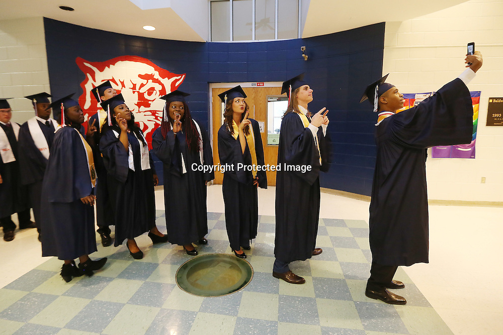 Lauren Wood | Buy at photos.djournal.com<br /> Joshua Lightning, right, takes a selfie with his classmates as they and other Baldwyn seniors line up Friday evening before their commencement ceremony at the high school.