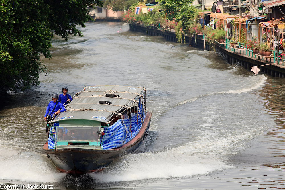 """Mar 19, 2009 -- BANGKOK, THAILAND: A khlong boat carries passengers on """"Khlong Saem Saeb"""" in central Bangkok, Thailand. Bangkok used to be crisscrossed by a series of khlongs (canals) and was called the Venice of the East. Many of the khlongs have been filled in during the last 30 years and now there are only a few left that still have regular passenger service.   Photo by Jack Kurtz"""