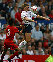 Photo: Paul Thomas.<br /> England v Andorra. European Championships 2008 Qualifying. 02/09/2006.<br /> <br /> Steven Gerrard of England (R) wins thje ball ahead of Javier Sanchez.