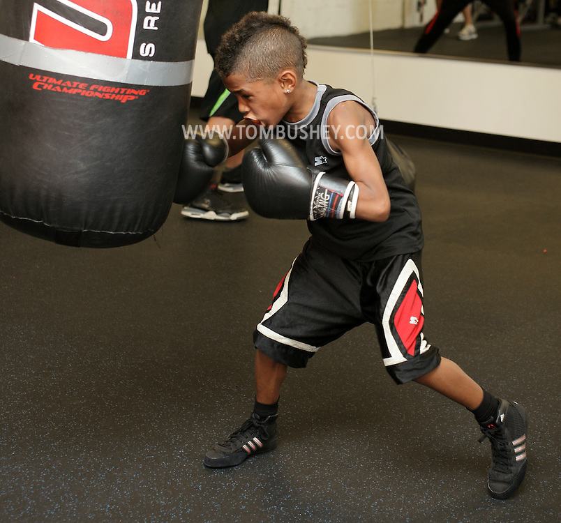 Terrence Thomas II, an 8-year-old boxer, trains at the Newburgh Boxing Club on Wednesday, Aug. 8, 2012.