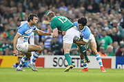 Keith Earls of Ireland is tackled by Matias Moroni of Argentina during the Rugby World Cup Quarter Final match between Ireland and Argentina at Millennium Stadium, Cardiff, Wales on 18 October 2015. Photo by Shane Healey.