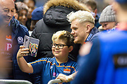 Darcy Graham (#14) of Edinburgh Rugby poses with a young fan after the final whistle of the 1872 Cup second leg Guinness Pro14 2019_20 match between Edinburgh Rugby and Glasgow Warriors at BT Murrayfield Stadium, Edinburgh, Scotland on 28 December 2019.