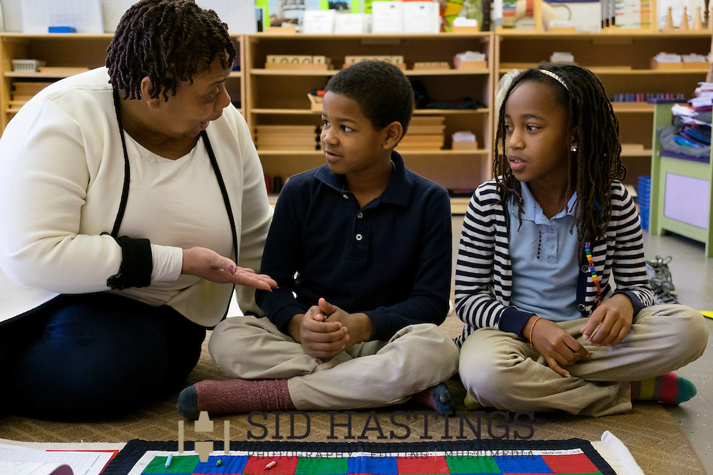 29 Feb. 2016 -- ST. LOUIS -- City Garden Montessori School teacher Darcell Butler (left), the Lead Guide for &quot;The Crew of 321,&quot; works on mathematics with students Demond Francis and Zion Hicks during class at the school in St. Louis Monday, Feb. 29, 2016. According to Dr. Nicole Evans, City Garden principal, the class includes students who in a traditional school would be in first, second and third grades. City officials report that success of the school, which serves students in the Shaw, Botanical Heights, Forest Park Southeast, Tiffany and Southwest Garden neighborhoods, has resulted in expanded home renovation and construction in some of the neighborhoods served.<br /> <br /> Photo &copy; copyright 2016 Sid Hastings.