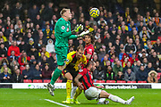 AFC Bournemouth goalkeeper Aaron Ramsdale (12) makes a save as AFC Bournemouth defender Steve Cook (3) tussles with Watford defender Craig Dawson (4) during the Premier League match between Watford and Bournemouth at Vicarage Road, Watford, England on 26 October 2019.