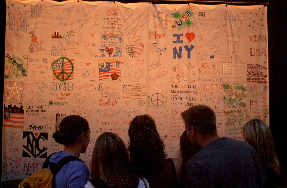 154989/11 Memorial 2002 one year since attacks Ceremony & Vigil, Students look at quilt