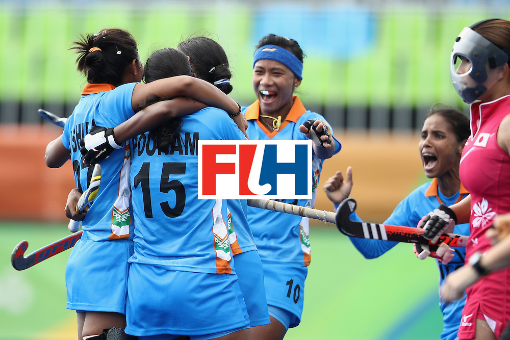 RIO DE JANEIRO, BRAZIL - AUGUST 07:  Rani of India celebrates with her team mates after scoring a goal during the women's pool B match between Japan and India on Day 2 of the Rio 2016 Olympic Games at the Olympic Hockey Centre on August 7, 2016 in Rio de Janeiro, Brazil.  (Photo by Mark Kolbe/Getty Images)