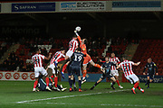 Will Boyle challenges Joe Murphy   during the EFL Sky Bet League 2 match between Cheltenham Town and Bury at LCI Rail Stadium, Cheltenham, England on 5 March 2019.