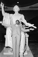 Mohammad Ali clowns on the statue of George Washington that in the Smithsonian Institution Museum of American History in March 1976. Photograph by Dennis Brack