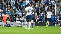 Football - 2019 / 2020 Premier League - Tottenham Hotspur vs. Watford<br /> <br /> Dele Alli (Tottenham FC) pounces on the mistake after Ben Foster (Watford FC)  and Kiko Femenía (Watford FC) collide to score the equaliser at The Tottenham Hotspur Stadium.<br /> <br /> COLORSPORT/DANIEL BEARHAM