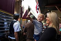 Easton and Liana Crowell about to board the 12 o'clock train out of the Laconia Train Station during the 125th celebration on Saturday.  (Karen Bobotas/for the Laconia Daily Sun)