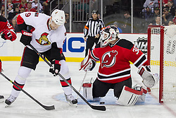 Dec 18, 2013; Newark, NJ, USA;  New Jersey Devils goalie Martin Brodeur (30) makes a save on a tip by Ottawa Senators left wing Milan Michalek (9) during the first period at the Prudential Center.