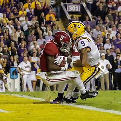 Nov 3, 2018; Baton Rouge, LA, USA; Alabama Crimson Tide wide receiver Henry Ruggs III (11) scores past LSU Tigers safety Grant Delpit (9) during the first quarter at Tiger Stadium. Mandatory Credit: Derick E. Hingle-USA TODAY Sports