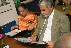Couple looking at a menu in a restaurant,