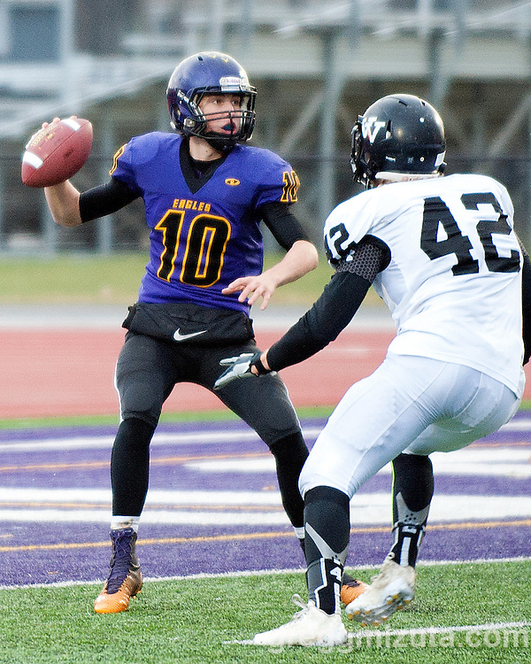 Vale's Sage Delong pressures Harrisburg quarterback Tel Jones during the Oregon 3A State Championship, Kennison Field, Hermiston, Oregon, November 29, 2014. Vale defeated Harrisburg 45-19 to win the 3A State Championship and finish with a 12-0 season record. <br /> <br /> Jones passed for 2 touchdowns and was 20-26-1 for 203 yards. Delong led the Viking defense with 7 solo tackles, 5 assists and a forced fumble.