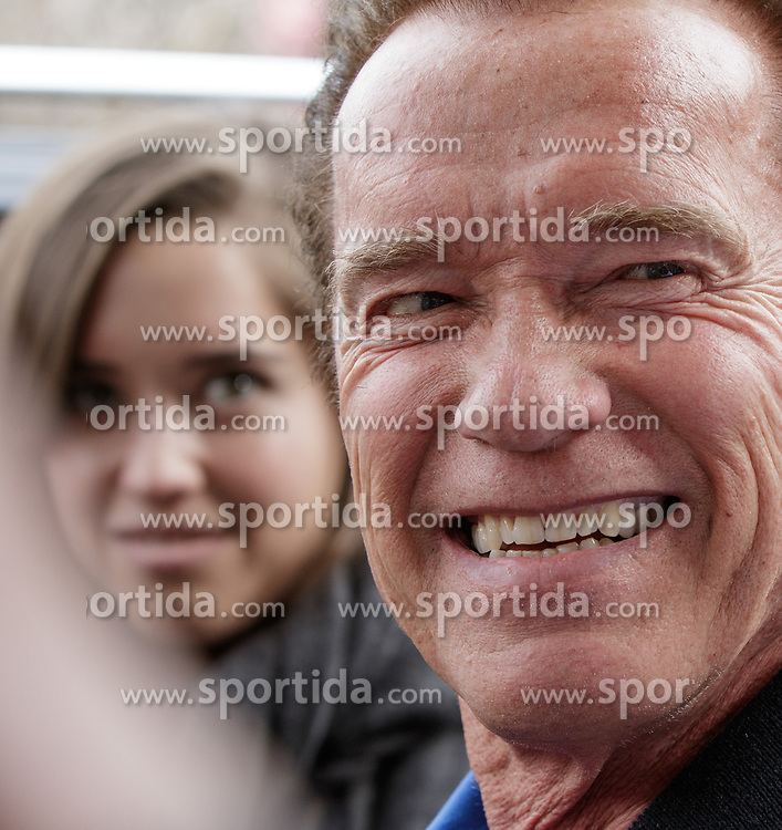 23.03.2017, Sporthotel Royer, Schladming, AUT, Special Olympics 2017, Wintergames, Arnold Schwarzenegger besucht die Spiele, im Bild Arnold Schwarzenegger, der lacht, Porträt Tochter Christina im Hintergrund // during the Special Olympics World Winter Games Austria 2017 in Schladming, Austria on 2017/03/23. EXPA Pictures © 2017, PhotoCredit: EXPA / Martin Huber