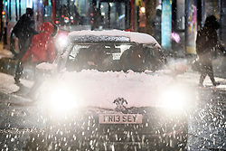 © Licensed to London News Pictures. 01/02/2019. London, UK. A car covered in snow on the Edgware Road in central London as large parts of the UK are deluged with snow and freeing temperatures. Photo credit: Ben Cawthra/LNP
