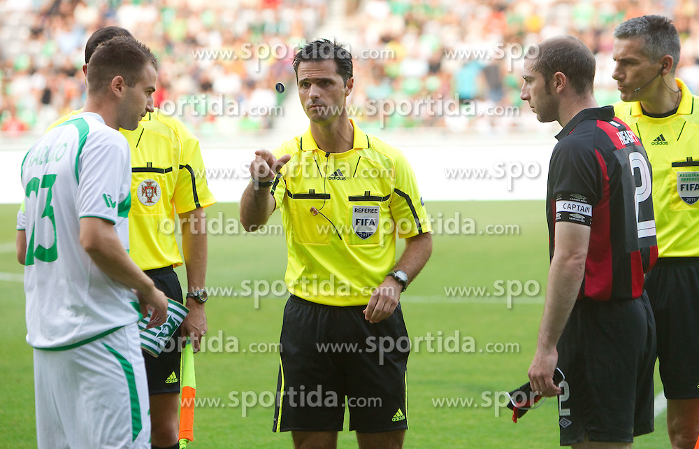 Referee Carlos Miguel Taborda Xistra (C) with players Dalibor Radujko of NK Olimpija Ljubljana and Owen Heary of FC Bohemian during football match between NK Olimpija Ljubljana (SLO) and FC Bohemian Dublin (IRE) of 1st Leg of Europa League Second Qualifying Round, on July 14, 2011, in  SRC Stozice, Ljubljana, Slovenia. Olimpija defeated Bohemians 2 - 0. (Photo by Vid Ponikvar / Sportida)