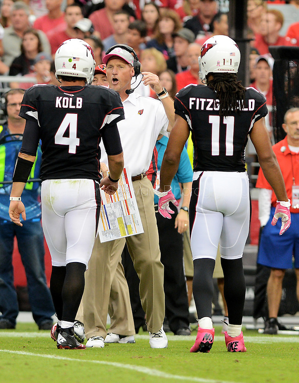 Oct. 14, 2012; Glendale, AZ, USA; Arizona Cardinals head coach Ken Whisenhunt talks with quarterback Kevin Kolb (4) and wide receiver Larry Fitzgerald (11) in the first half during the game against the Buffalo Bills at University of Phoenix Stadium. Mandatory Credit: Jennifer Stewart-US PRESSWIRE..