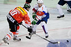 Andres Ambuhl of Switzerland vs Ales Music of Slovenia during friendly ice-hockey match between Slovenia and Switzerland, on December 14, 2011 at Hala Tivoli, Ljubljana, Slovenia. (Photo By Matic Klansek Velej / Sportida)