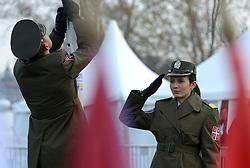08-12-2013 ATHLETICS: SPAR EC CROSS COUNTRY: BELGRADE<br /> Senior vrouwen / Militair salueert tijdens ceremonie<br /> ©2013-WWW.FOTOHOOGENDOORN.NL