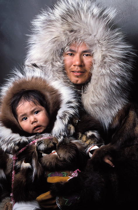 Iñupiaq father and daughter in traditional dress parkas with wolf ruffs