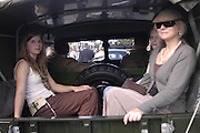 Katie and Julia Baxter in the back of a jeep, Goodwood Revival Meeting. Saturday 17 September 2005.  ONE TIME USE ONLY - DO NOT ARCHIVE  © Copyright Photograph by Dafydd Jones 66 Stockwell Park Rd. London SW9 0DA Tel 020 7733 0108 www.dafjones.com