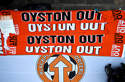 Oyston Out scarves are layed out in protest prior to the beginning of the Emirates FA Cup, third round match at Bloomfield Road, Blackpool.