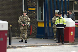 © London News Pictures. 23/05/2013. Woolwhich, UK. Soldiers and security staff guard Woolwich Barracks in Woolwhich, London where a member of the armed forces was attacked by two men in what is being described as a terrorist attack. Photo credit: Ben Cawthra