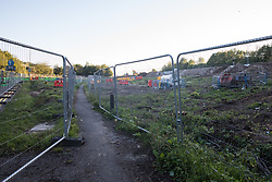 Fencing is positioned around land cleared of trees and undergrowth at the HS2 Buckinghamshire Junctions Laydown Area on 17th July 2020 in Amersham, United Kingdom. The Department for Transport approved the issuing of Notices to Proceed by HS2 Ltd to the four Main Works Civils Contractors (MWCC) working on the £106bn high-speed rail link project in April 2020.