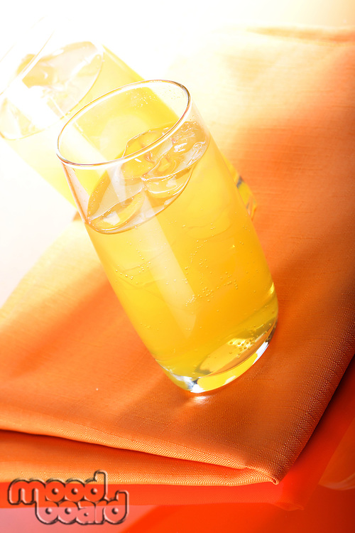 Glass of orange juice with ice