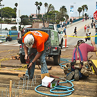 Pile drivers  from the John S. Meek Company, Inc. replace boards at the Santa Monica Pier on Thursday, August 23, 2012.