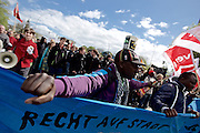 Hamburg | 01 May 2015<br /> <br /> 4000 protesters take part in the &quot;Never Mind The Papers&quot; rally for migrants and refugees in the german city of Hamburg. Picture shows a Lampedusa refugee behind a banner.<br /> <br /> &copy;peter-juelich.com<br /> <br /> [Foto honorarpflichtig | Fees Apply | No Model Release | No Property Release]