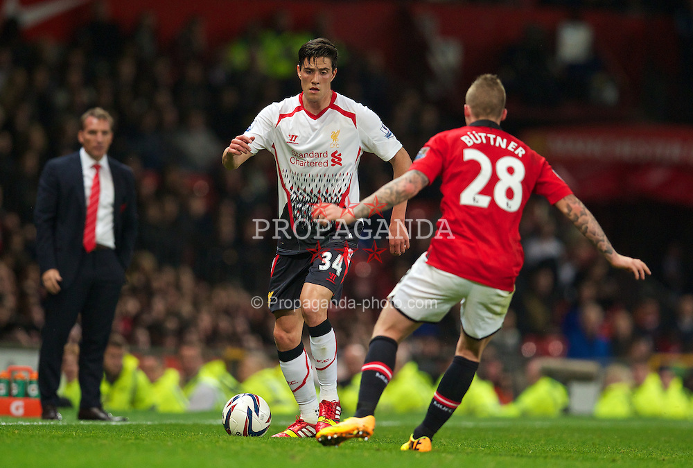 MANCHESTER, ENGLAND - Wednesday, September 25, 2013: Liverpool's Martin Kelly in action against Manchester United during the Football League Cup 3rd Round match at Old Trafford. (Pic by David Rawcliffe/Propaganda)