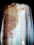 Artifacts - including vestments worn by  the martyr Archbishop Oscar Romero when he was assassinated - on display in the priests residence turned museum across from the Church of the Divine Providence. The Archbishop was slain at the alter of his Church of the Divine Providence by a right wing gunman in 1980. Óscar Arnulfo Romero y Galdámez was a bishop of the Catholic Church in El Salvador. He became the fourth Archbishop of San Salvador, succeeding Luis Chávez, and spoke out against poverty, social injustice, assassinations and torture. Romero was assassinated while offering Mass on March 24,1980. - To license this image, click on the shopping cart below -